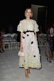 Elena Perminova looked very feminine in her flower-appliqued dress during the Giambattista Valli Couture show.
