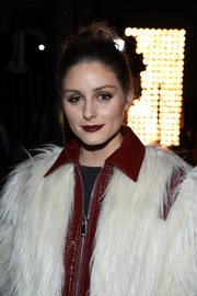 Olivia Palermo pulled her locks back into a twisted bun for the Giambattista Valli Fall 2018 show.