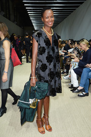 Shala Monroque attended the Giambattista Valli fashion show looking pretty in a gray A-line dress with floral velvet embellishments.
