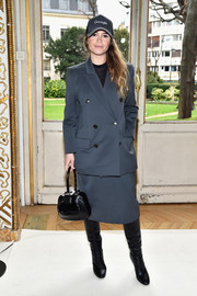Miroslava Duma was office-chic in a slate-blue skirt suit while attending the Giambattista Valli fashion show.