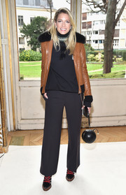 Helena Bordon toughened up in a tan leather flight jacket by Tod's for the Giambattista Valli fashion show.