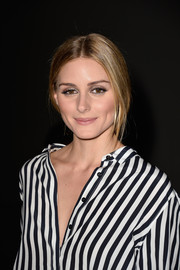 Olivia Palermo styled her hair in a loose center-parted ponytail for the Giambattista Valli Couture show.
