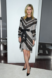 Nicky Hilton went for a ladylike gray and black lace dress by Giambattista Valli during the brand's Fall 2019 show.
