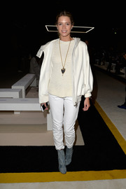 Helena Bordon attended the Giambattista Valli fashion show looking sporty in a white Dior track jacket.