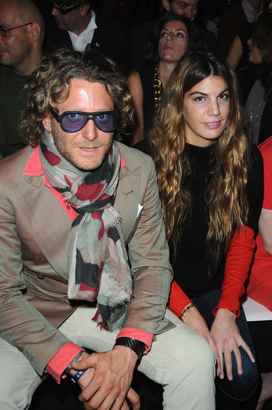 Lapo Elkann pulled his colorful look together with a print scarf at the Giambattista Valli fashion show.
