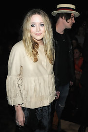 Mary-Kate is haute hippie in a buttery beige leather jacket with fringe.