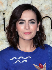Camilla Belle wore her hair in shoulder-length waves at the Gigi C Bikinis pop-up launch event.