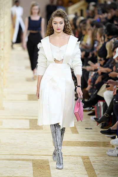 Gigi Hadid Lace Up Boots [fashion model,fashion,fashion show,runway,white,clothing,haute couture,shoulder,event,public event,gigi hadid,miu miu,miu miu womenswear spring,part,runway,summer 2020,paris,france,paris fashion week,show]