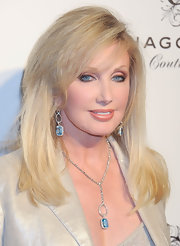 Morgan Fairchild accessorized with an exquisite pair of dangling gemstone earrings and a matching necklace at the Chagoury Couture debut.