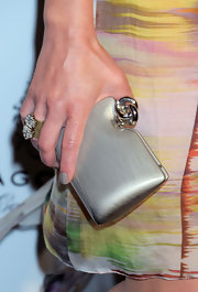 Elizabeth Rohm showed off her brushed metal box clutch while attending an LA event. It looked great when paired with her colorful dress.