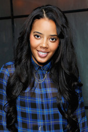 Angela Simmons styled her super-long hair with spiral curls for the 5050 boot anniversary.