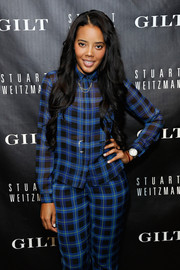 Angela Simmons piled on the plaid with this button-down and pants combo at the 5050 boot anniversary.