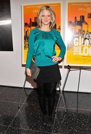 Arden Myrin kept her evening look minimalistic with this black mini skirt.
