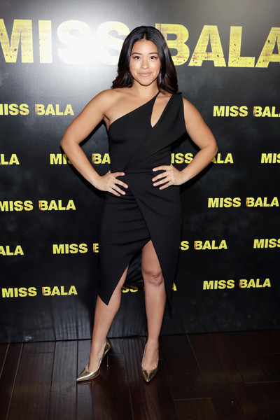 Gina Rodriguez Evening Pumps [summer and beyond films,fashion model,shoulder,little black dress,flooring,leg,carpet,long hair,thigh,girl,gina rodriguez,sony pictures entertainment exclusive presentation,caesars palace,the colosseum,cinemacon,sony pictures highlights,cinemacon 2018 gala opening night event,opening night event,convention]