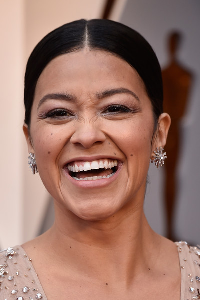Gina Rodriguez Ponytail [face,hair,eyebrow,skin,facial expression,smile,chin,forehead,head,nose,arrivals,gina rodriguez,academy awards,hollywood highland center,california,90th annual academy awards]