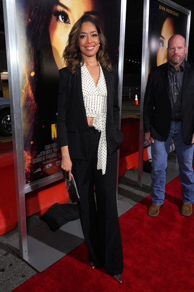 Gina Torres Pantsuit [red carpet,carpet,premiere,flooring,event,suit,fashion,long hair,outerwear,formal wear,red carpet,gina torres,columbia pictures miss bala,california,los angeles,regal la live stadium,premiere,premiere]