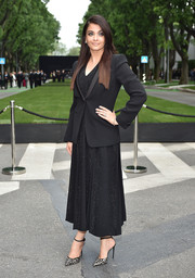 Aishwarya Rai layered a black tuxedo jacket over a sparkly dress for the Giorgio Armani 40th anniversary reception.