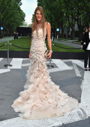 Anna dello Russo was her usual flamboyant self in this cream-colored Armani Prive gown, rendered in layers and layers of tulle, during the Giorgio Armani 40th anniversary reception.