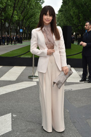 Miroslava Duma teamed a cream-colored pantsuit with a sheer tie-neck blouse for the Giorgio Armani 40th anniversary reception.