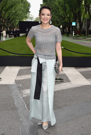 Zhang Ziyi paired her top with bow-adorned mint-green wide-leg pants by Giorgio Armani.