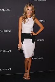 Laura Dundovic went for a stylish modern look with this sleeveless white cocktail dress with a black peplum waist at the Giorgio Armani Beauty Counter opening.
