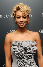 Keri Hilson loves to switch up her glamorous look. The singer showed off blond curls at the screening of 'Fair Game.'