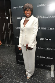 Viola Davis kept the focus on her ivory suit, pairing it with gold peep-toes and a woven bronze box clutch.