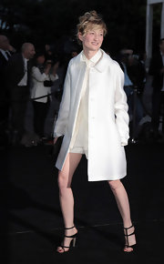 Alba Rohrwacher chose a classic white coat for her sleek monochromatic ensemble.
