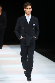 Jon walked the Armani runway in a double breasted navy suit by the designer.