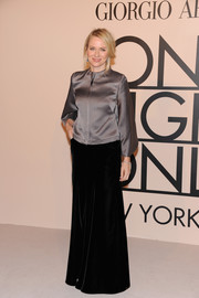 Naomi Watts looked very polished in her long black velvet skirt and gray silk blouse at the Giorgio Armani SuperPier show.