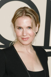 Renee Zellweger opted for casual styling with this center-parted ponytail when she attended the Giorgio Armani SuperPier show.