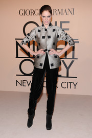 Coco Rocha attended the Giorgio Armani SuperPier show wearing black velvet slacks and a silver jacket, both by Armani.