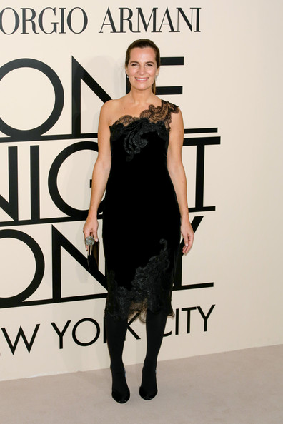 Roberta Armani was the picture of elegance in a black one-shoulder dress with lace embellishments during the Giorgio Armani SuperPier show.
