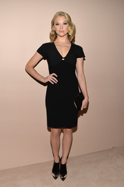 Natalie Dormer paired her classic dress with modern black Armani ankle boots with see-through panels.
