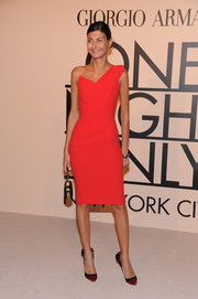 Giovanna Battaglia looked ultra sophisticated in a figure-hugging orange one-shoulder dress during the Giorgio Armani SuperPier show.