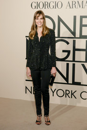 Hilary Swank looked flawless in black Armani skinnies and a sequined jacket during the Giorgio Armani SuperPier show.