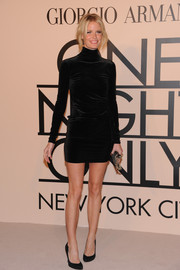 Caroline Winberg showed off her mile-long legs in a short black velvet dress during the Giorgio Armani SuperPier show.