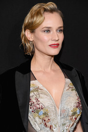 Diane Kruger attended the Armani Prive fashion show rocking a modern finger wave.