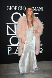 Anna dello Russo stepped up the glamour in a pink fur coat layered over a glittery silver gown at the Giorgio Armani fashion show.