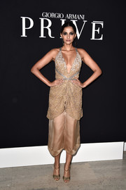 Sonam Kapoor polished off her look with gold T-strap evening sandals.