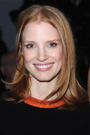 Jessica Chastain attended the Giorgio Armani Prive fashion show in Paris wearing her silky tresses sleek and straight.