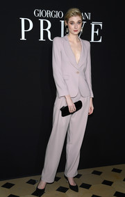 Elizabeth Debicki opted for a simple lilac pantsuit when she attended the Armani Prive fashion show.