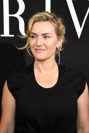 Kate Winslet attended the Armani Prive fashion show sporting a messy updo.