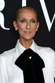 Celine Dion kept it super simple with this slicked-down updo at the Armani Prive Spring 2019 show.