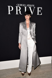 Paz Vega made a grand entrance at the Giorgio Armani Prive show in a super-sophisticated silver coat.