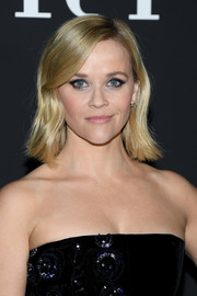 Reese Witherspoon framed her face with a subtly wavy hairstyle for the Armani Prive Spring 2020 show.