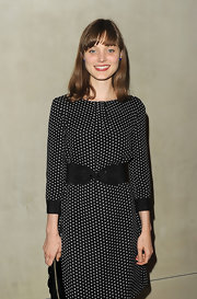 Bella Heathcote showed off her curves by wearing a wide belt on top of her Armani dress.