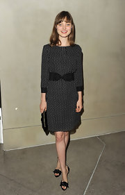 Bella Heathcote accessorized her polka-dote frock with black satin d'orsay pumps.