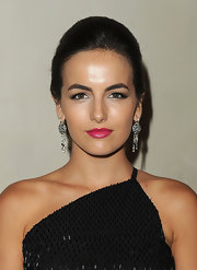 Camilla Belle complemented her 'do with a pair of Art Deco-style diamond chandelier earrings by Cartier.