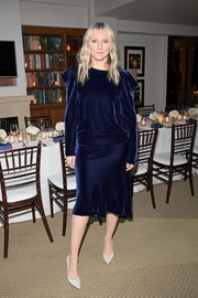 Laura Brown slipped into a draped navy velvet dress for the Stuart Weitzman Beverly Hills boutique opening.